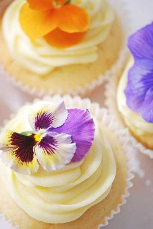 White Wedding Cupcakes With Purple Edible Flowers