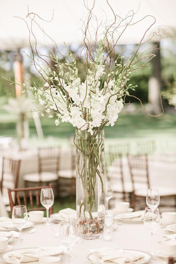 Elegant Wedding Centerpiece With Tall Clear Vase