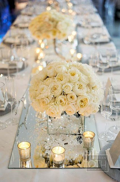 Elegant White Wedding Centerpiece With Candles In Glasses