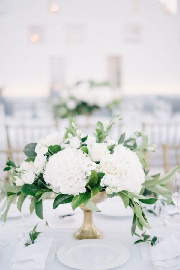 Elegant White Wedding Centerpiece With Green Leaves