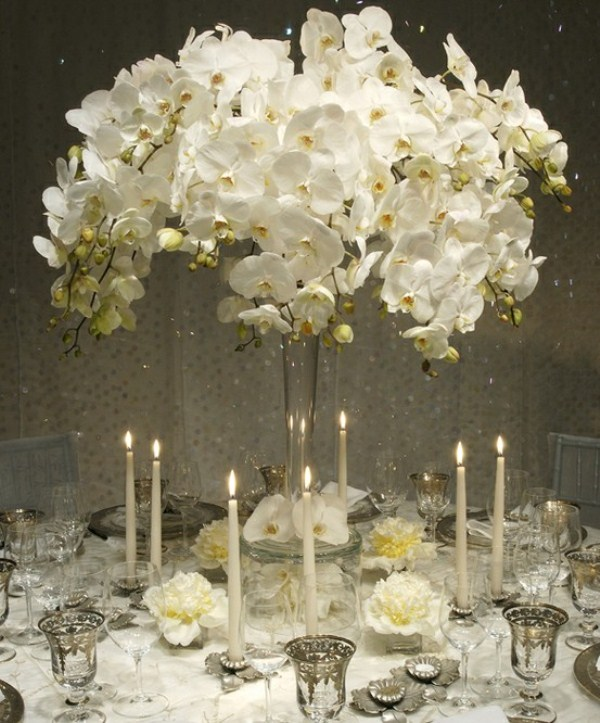 Elegant White Wedding Centerpiece With White Orchid In Tall Vase